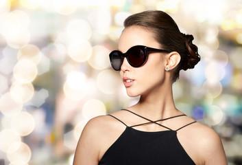 beautiful young woman in elegant black sunglasses