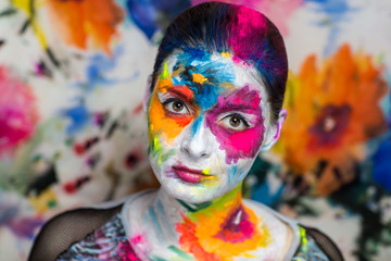 Portrait of beautiful young girl, woman, lady,model,painting, canvas, crazy art, painting,expressionism. Bright creative makeup, expressive eyes, paint, colorful, yellow, blue, pink, white flowers.