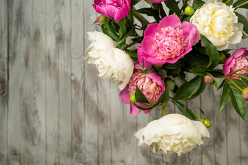 Bouquet of beautifull peonies flowers. Top view.