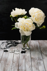 Bouquet of white peonies in a vase.