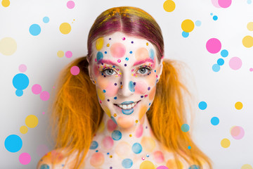 Very positive, bright, extraordinary picture. Candy Lady Art Makeup. Young smiling girl with creative body-art, vanilla girl. Party leaflet, advertisement, cosmetics, jewelry, food, blog, web-cite.