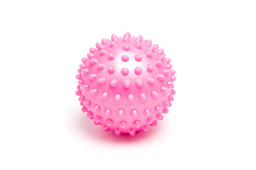 Pink spiky massage ball on white background