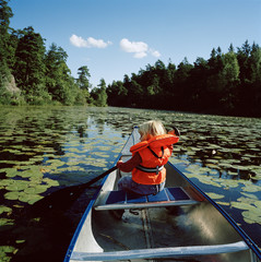 A child in a  canoe.