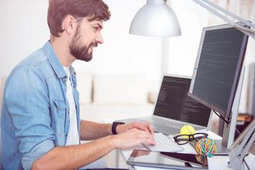 Man programming on his computer