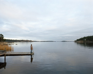 A woman on a jetty.