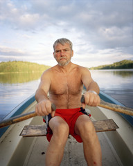 A man rowing.