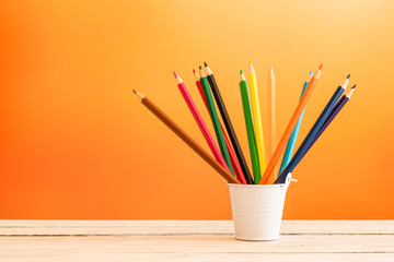 Color pencils in a white bucket