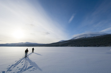 Two persons skiing.
