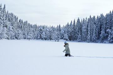 A woman skiing in deep snow.