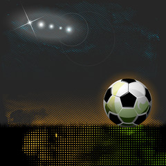 Football ball on grass sport background