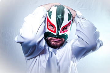 Frustrated, angry businessman with Mexican wrestler mask, expres