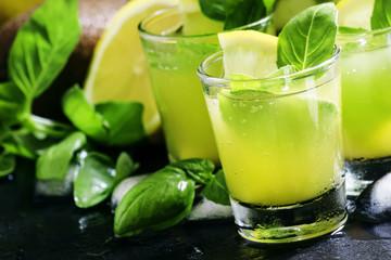 Spicy fruit lemonade with basil, kiwi, lemon, soda and ice, blac