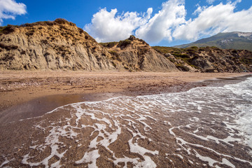 Sandy beach with cliffs in hot summer day Kalamaki Zakynthos Greece