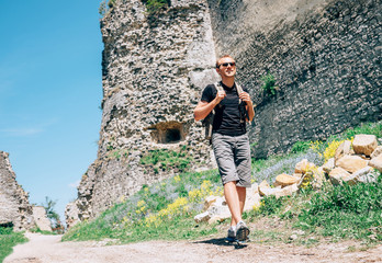 Man tourist walk on the old castle ruin territory