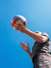 Man on volleyball service