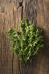 Fresh thyme sitting on a rustic background.