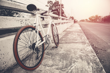 beautiful image with sport vintage bicycle at roadside ; vintage