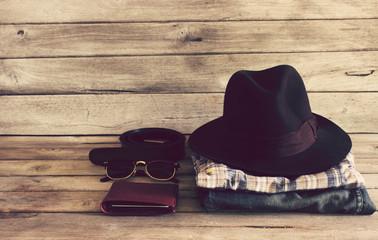 Vintage,Plaid shirt,Wallet,sunglasses,Hat,Belt,Jean on wood back