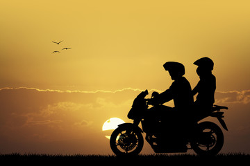 couple on motorcycle at sunset