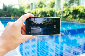 photo shooting on smartphone at swimming pool