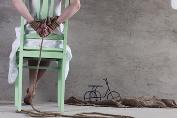 girl hands bound prisoner