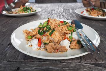 Basil Fried Rice on wood floor.