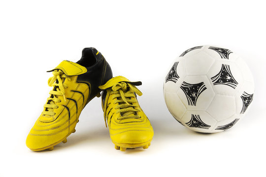 equipment for soccer player / over-white portrait of a pair of football shoes