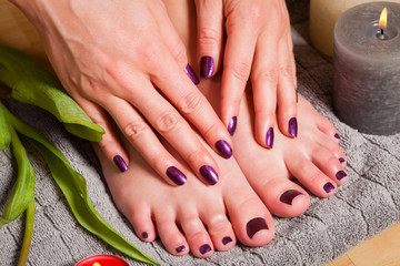 Close up of woman with pedicure and manicure