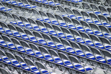 Rows of blue folding chairs for ceremony