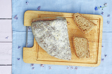 Fresh, home baked soda bread on wooden cutting board, close up