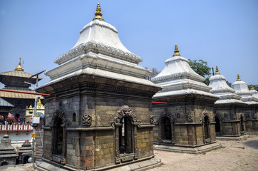 Votive temples and shrines in a row at Pashupatinath Temple, Kathmandu, Nepal - Sri Pashupatinath Temple located on the banks of the Bagmati River.