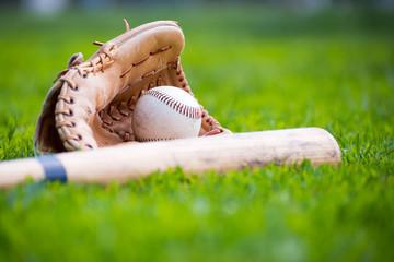 Baseball & Glove on Baseball Field