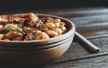 beans with meat and tomato sauce, rustic style
