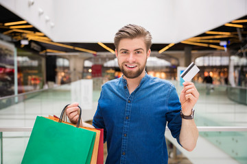 Happy man shopping