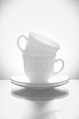 Cups for tea with saucers on a white background