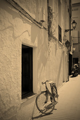 bicycle at a white wall