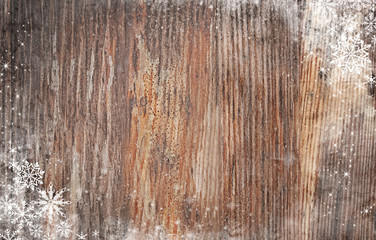 Wooden background with snow effect