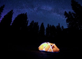 Orange Tent under Milky Way at Night. Crater Lake National Park, Oregon, USA.
