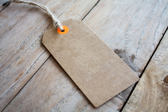 Blank price tag on wood background