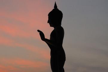 Buddha stand after sunset