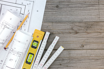 architectural blueprints with contractor work tools with floor p