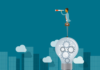 business vision concept and business man standing on lightbulbs