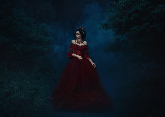 dark evil queen sneaks through the dark forest at night,   Princess in red dress , vampire , hip toning , creative color,dark boho
