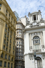 Classic neoclassical architecture in Cinelândia includes the Palácio Pedro Ernesto and the yellow-hued Wolfgang Amadeus Mozart building (Amarelinho) in Rio de Janeiro, Brazil