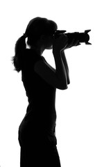 woman takes a photo by camera