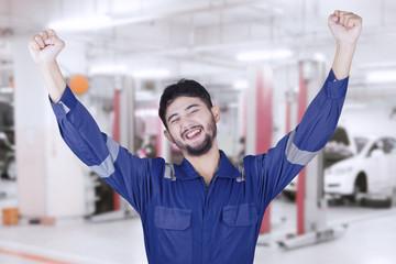 Mechanic celebrates his success in workshop