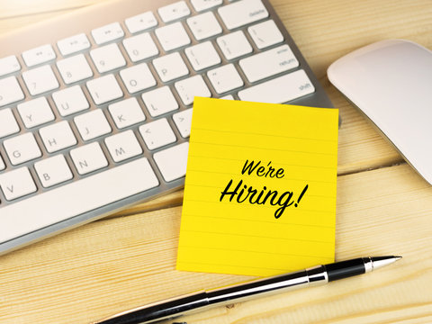 We are hiring on sticky note on work table