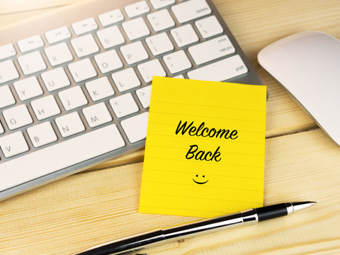 Welcome back with smiley on work table