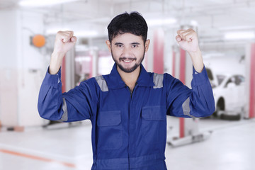 Young mechanic expressing his success