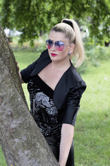 the beautiful woman in black at a tree